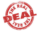 The Real Deal words in red ink grunge style stamp — Stock Photo