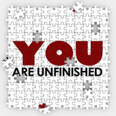 You Are Unfinished words on puzzle pieces — Stock Photo
