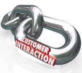 Customer Interaction words in red 3d letters on metal chain links — Stock Photo