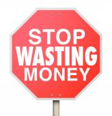 Stop Wasting Money words on a red warning sign — Stock Photo