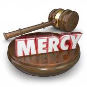 Mercy 3d word in red letters on a gavel — Stock Photo