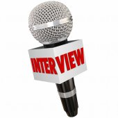 Interview word on a reporter's microphone — Stock Photo