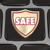 Safe word on a gold shield on computer keyboard key — Stock Photo