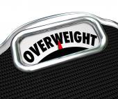 Overweight word on a scale — Stock Photo
