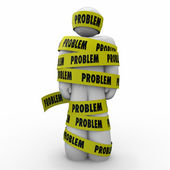 Problem word on yellow tape wrapped around a person — Stock Photo