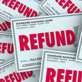 Refund word on checks — Stock Photo