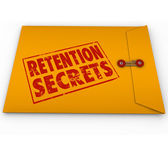 Retention Secrets word stamped in grunge red ink style on a yellow envelope — Stock Photo