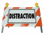 Distraction word on a road construction barrier — Stock Photo