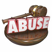 Abuse word in red 3d letters beside a wooden gavel — Stock Photo