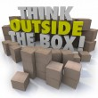 Think Outside the Box 3d words surrounded by cardboard boxes — Stock Photo #74480091
