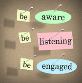 Be Aware, Listening and Engaged words on papers pinned to a bulletin or message board — Stock Photo