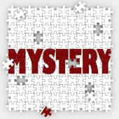 Mystery word on puzzle pieces — Stock Photo