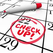 Check Up words on a calender written by red pen — Stock Photo