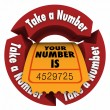 Take a Number words in red arrows around a ticket — Stockfoto #77197787