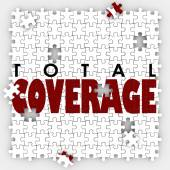 Total Coverage words on puzzle pieces — Stock Photo