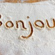 Words in flour — Stock Photo #71039379