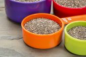 Chia seeds in measuring cups  — Stockfoto