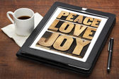 Peace, love and joy on a tablet — Stockfoto