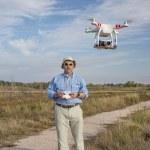 Постер, плакат: Flying quadcopter drone