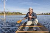 Enjoying  morning canoe paddling — Stock Photo