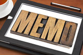 Memo word on tablet — Stock Photo