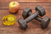 Fitness concept with dumbbells — Stock Photo