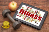 Fitness word cloud on a tablet — Stock Photo