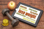 Lose weight - tips on a tablet — Stock Photo