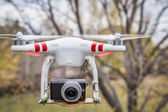 Airborne Phantom quadcopter drone  — Stock Photo