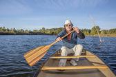 Enjoying canoe paddling on lake — Stock Photo