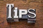 Tips word in metal type — Stock Photo