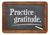 Practice gratitude on blackboard — Stock Photo