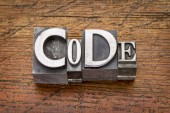 Code word in  metal type  — Stock Photo