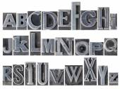 Alphabet in mixed metal type — Stock Photo