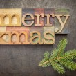 Merry Christmas in wood type — Stock Photo #60755825