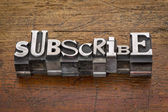 Subscribe word  in metal type — Stock Photo