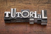 Tutorial word in metal type — Stockfoto
