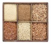 Gluten free grains in rustic box — Stock Photo