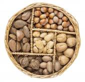 Nuts in a basket tray — Stock Photo