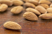 Almonds on wood table — Stock Photo
