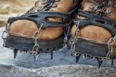 Hiking boots with crampons — Stock Photo