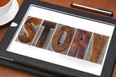 Story word on tablet — Stock Photo