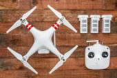 Quadcopter drome with  a radio controller and spare batteries — Stock Photo