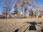 Quadcopter drone shadow and city — Stock Photo