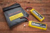 LiPO batterires with protective charging bags — Stock Photo
