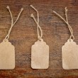 Blank paper price tags on rustic wood — Stock Photo #71259259
