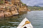 Canoe and sandstone cliff — Stock Photo