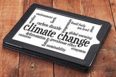 Climate change word cloud on tablet — Stock Photo
