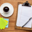 Desktop concept - clipboard, sticky notes and coffee — Stock Photo #72900027