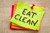 Eat clean reminder on sticky note — Stock Photo